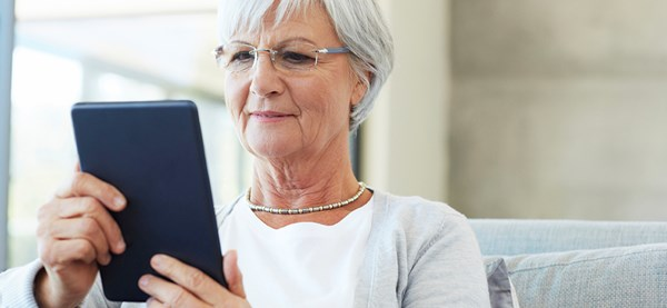 Elderly woman with a computer tablet