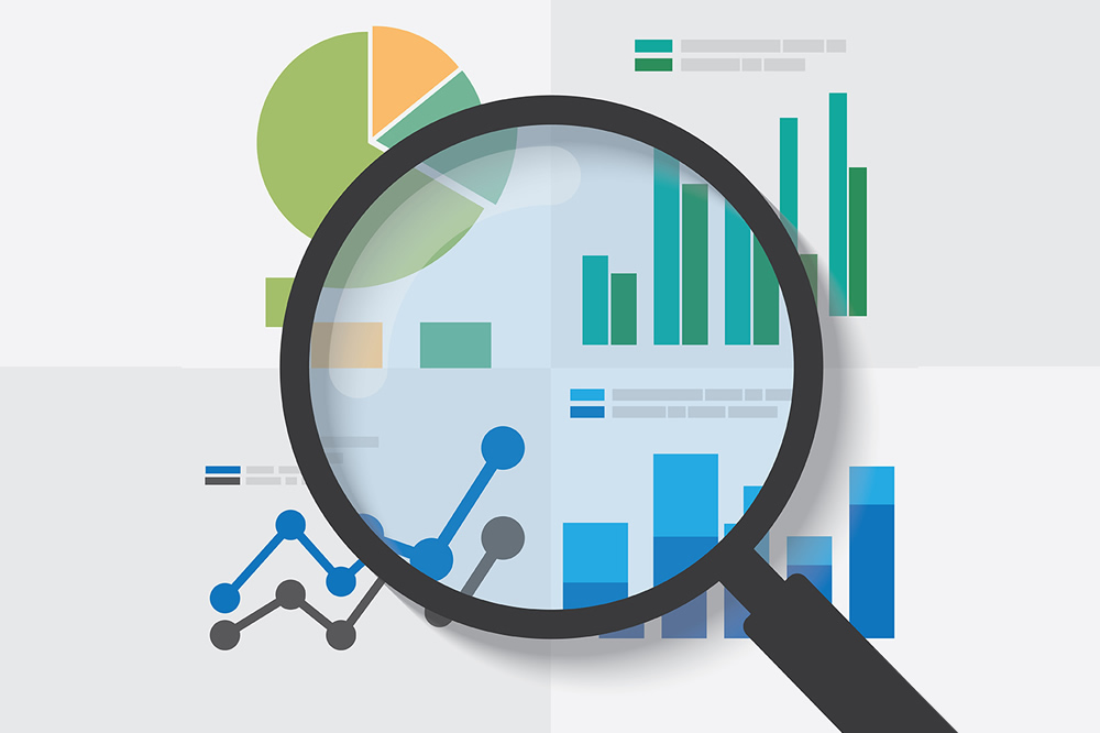 Magnifying glass on top of a report graphic